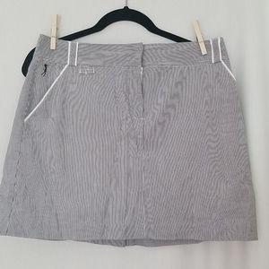 EUC golf skirt by Izod. Size 6. Blue/white